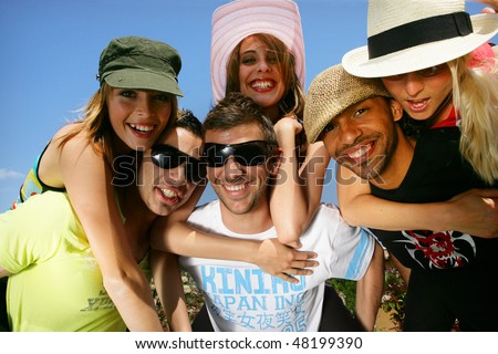 Group of friends having fun in summer - stock photo