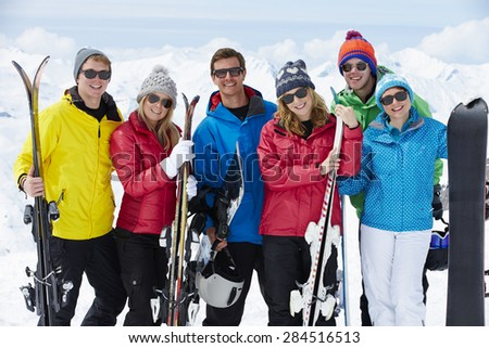 Group Of Friends Having Fun On Ski Holiday In Mountains - stock photo