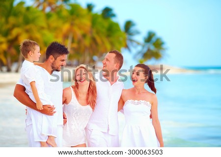 group of friends having fun on tropical beach, summer vacation - stock photo