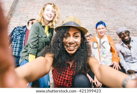 Group of friends having fun together and taking selfies - stock photo