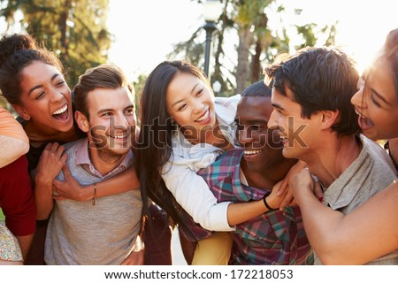 Group Of Friends Having Fun Together Outdoors - stock photo