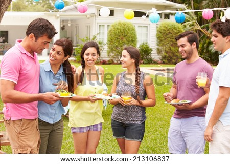 Group Of Friends Having Party In Backyard At Home - stock photo