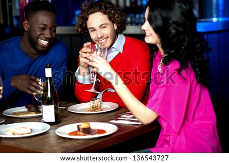 Group of friends having their dinner with drinks at a restaurant. - stock photo