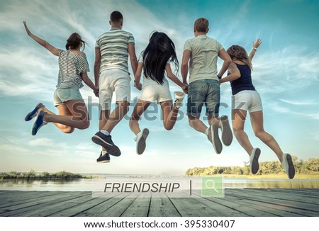 Group of friends jumping on the pier under sunlight. - stock photo