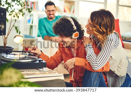 Group of friends listening music - vinyl at home - stock photo