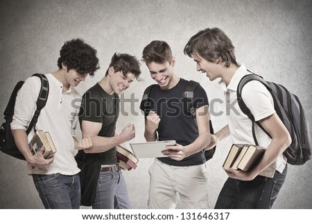 group of friends looking at the results cheers - stock photo