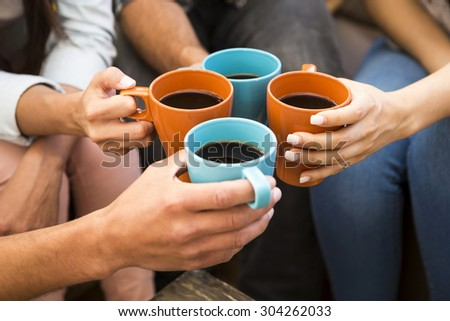 Group of friends making a toast with coffee - stock photo