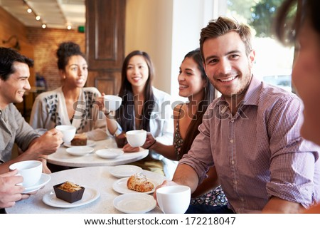 Group Of Friends Meeting In Caf���© Restaurant - stock photo