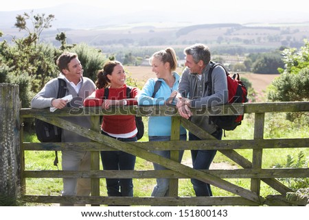 Group Of Friends On Country Walk - stock photo