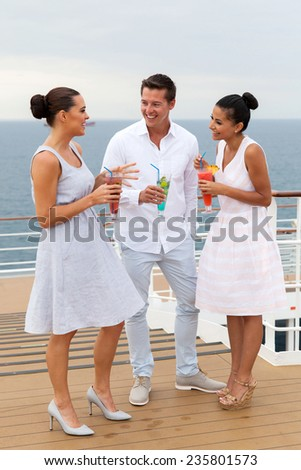 group of friends on cruise having cocktails - stock photo