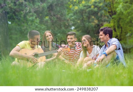 Group of friends playing music - stock photo