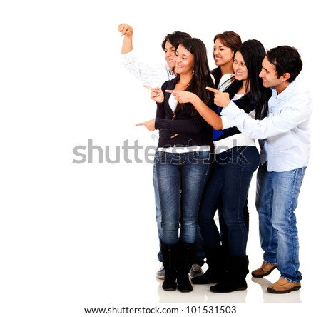 Group of friends pointing at an imaginary object - isolated over a white background - stock photo
