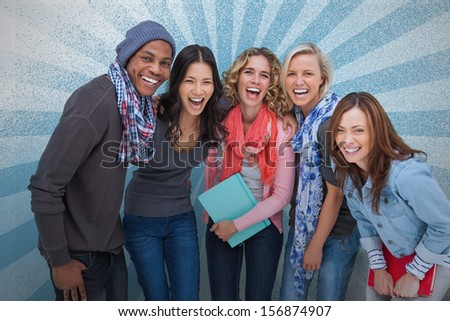 Group of friends posing together on blue background - stock photo