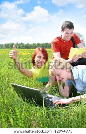 group of friends relaxing outdoors - stock photo