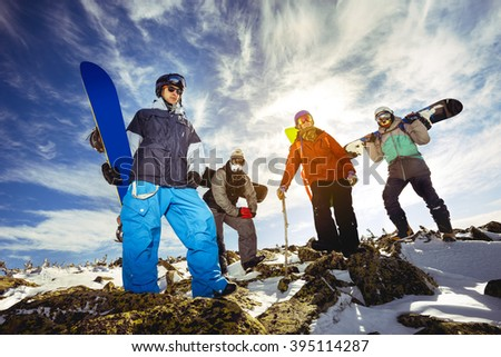 Group of friends snowboarders posing with snowboards. Sheregesh resort, Siberia, Russia - stock photo