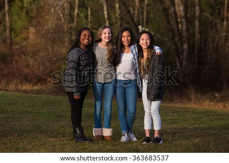 Group of friends standing together in unity outside - stock photo