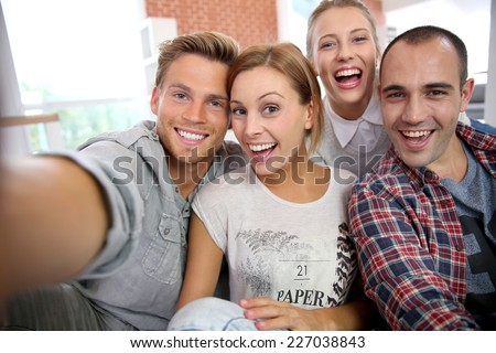 Group of friends taking picture of themselves - stock photo
