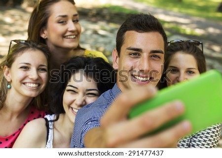Group of Friends Taking Selfie at Park  - stock photo