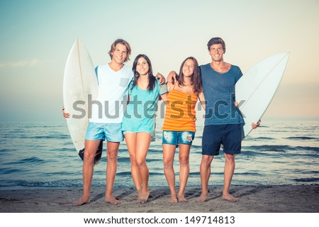 Group of Friends with Surf Boards - stock photo