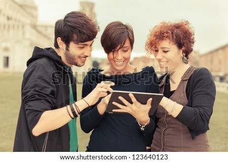 Group of Friends with Tablet PC Outside - stock photo