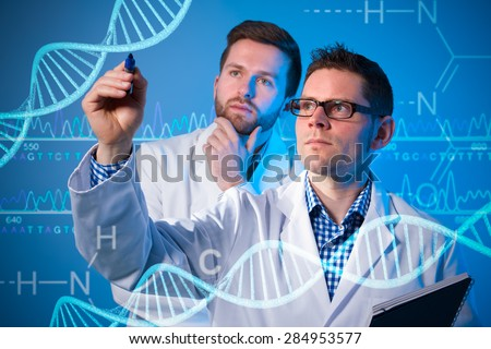 Group of geneticists working at media screen. Genetic engineering - stock photo