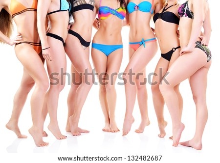 group of girls in bikini, seven attractive caucasian young women in swimsuits over white - stock photo