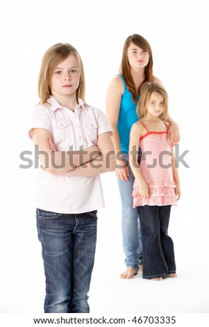 Group Of Girls Together In Studio Looking Unhappy - stock photo