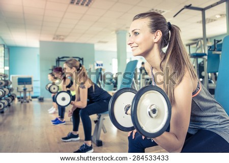 group of girls training in the gym with weights. concept about training and workout - stock photo