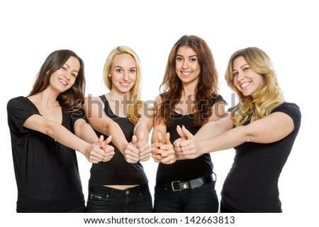 Group of girls with thumbs up isolated on white - stock photo