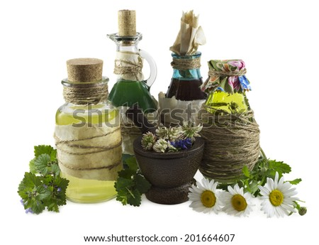 Group of glass bottles with healing herbs, homeopathic still life isolated on white - stock photo