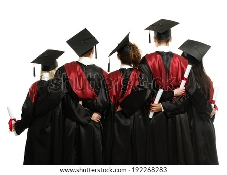 Group of graduated young students in black mantles  - stock photo