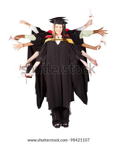 group of graduates having fun at graduation - stock photo
