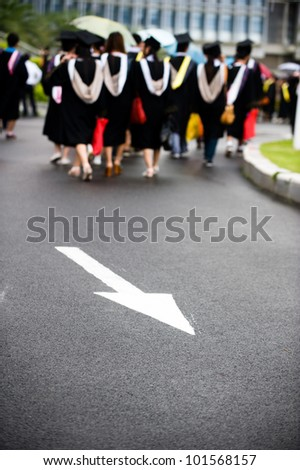 group of graduates on the road. - stock photo