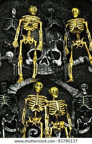 Group of grungy skeletons waiting on a head stone for Halloween or cinco de mayo - stock photo