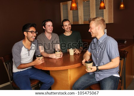 Group of guys at the Coffee Shop - stock photo