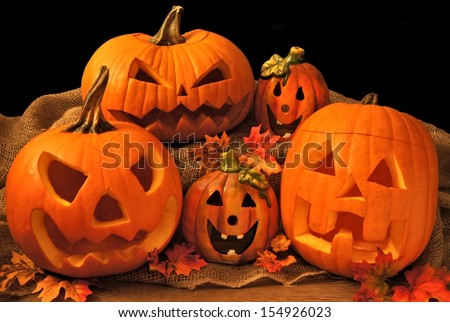 Group of Halloween Jack o Lanterns and decor  - stock photo
