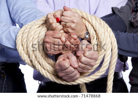 Group of hands arrested with a rope - stock photo