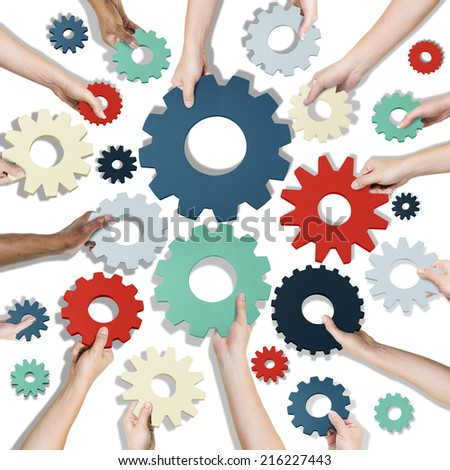 Group of Hands Holding Gears Symbol - stock photo
