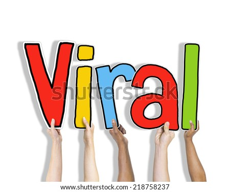 Group of Hands Holding Letter Viral - stock photo