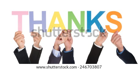 Group Of Hands Holding The Word Thanks Isolated Over White Background - stock photo