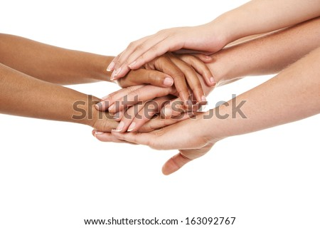 group of hands holding together on white isolated background - stock photo