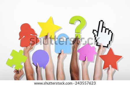 Group of Hands Holding Various Symbols Social Networking Concept - stock photo