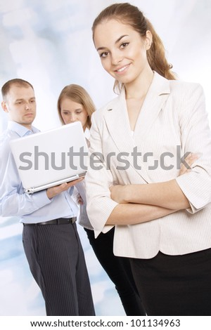 Group of happy business colleagues in a meeting together at office - stock photo