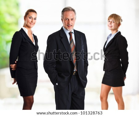 Group of happy business people in a bright office - stock photo