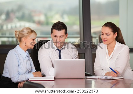 Group of happy business people in a meeting at modern office - stock photo