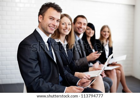 Group of happy business people sitting. - stock photo