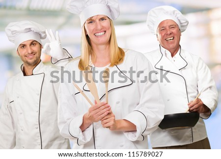 Group Of Happy Chef's At Work, Indoors - stock photo