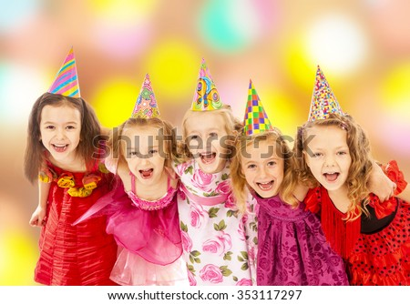 Group of happy children dancing at the carnival - stock photo