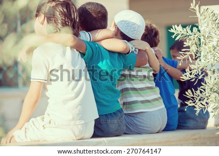Group of happy children from back - stock photo