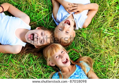 Group of happy children having fun outdoors. - stock photo